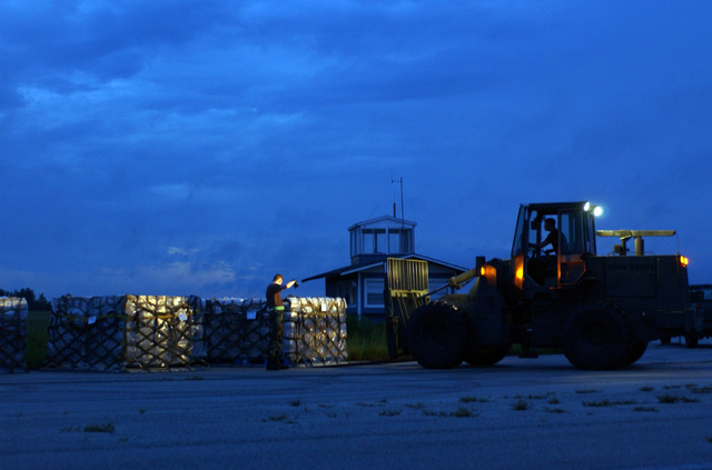 US Air Force (USAF) Airmen from the 621-8 tanker airlift control element (TALCE), McGuire Air Force Base (AFB), New Jersey (NJ), use a John Deere 544E 10K forklift to move pallets from a staging area providing support for Hurricane Charley relief efforts in Lakeland, Florida (FL). Lakeland Regional Airfield is the center of relief operations in Florida for the Federal Emergency Management Agency (FEMA). The USAF is providing support by transporting tons of equipment, personnel, and supplies via air, expediting the delivery of the needed supplies
