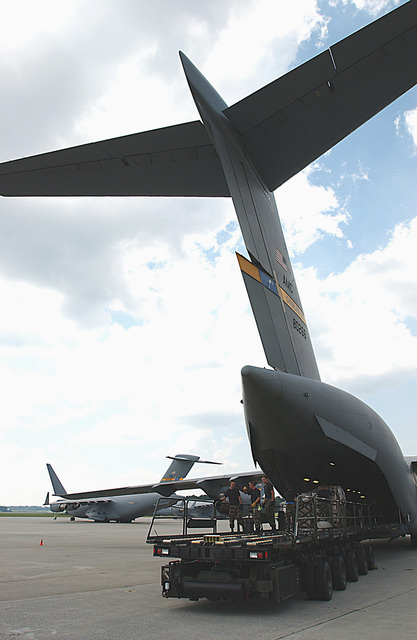 US Air Force (USAF) Airmen of the 437th Airlift Squadron (AS), Charleston Air Force Base (AFB), South Carolina (SC), deployed to Dobbins Air Reserve Base (ARB), Georgia (GA), load relief pallets off a TUNNER 60K Loader onto a USAF C-17A Globemaster III. They are supporting relief operations conducted by Federal Emergency Management Agency (FEMA) in response to Hurricane Charley victims of Florida (FL)