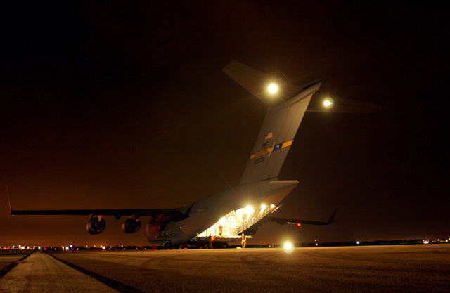 A US Air Force (USAF) C-17A Globemaster III, Charleston Air Force Base (AFB), South Carolina (SC), filled with relief supplies arrives late at night at Lakeland Regional Airfield, Lakeland, Florida (FL). Lakeland Regional Airfield is the center of relief operations in Florida for the Federal Emergency Management Agency (FEMA).  The Air Force is providing support by transporting tons of equipment, personnel, and supplies, via air; expediting the delivery of the needed items