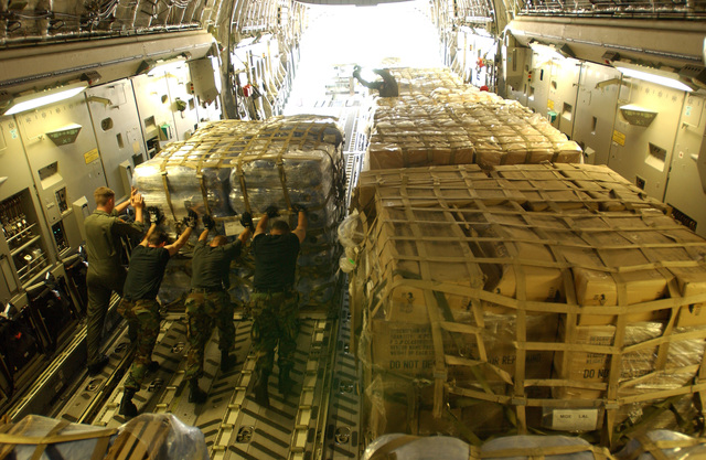 US Air Force (USAF) Airmen of the 621-8 Tanker Airlift Control Element (TALCE), McGuire Air Force Base (AFB), New Jersey (NJ), offload relief pallets from a USAF C-17A Globemaster III at Lakeland Regional Airfield, Lakeland, Florida (FL).  Lakeland Regional Airfield is the center of relief operations in Florida for the Federal Emergency Management Agency (FEMA).  The Air Force is providing support by transporting tons of equipment, personnel, and supplies, via air; expediting the delivery of the needed items