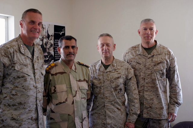 U.S. Marine Corps GEN. James L. Jones (left), Supreme Allied Commander Europe (SACEUR), the Commander of the Iraqi Army National Guard, MAJ. GEN. James N. Mattis, Commander, 1ST Marine Division (MARDIV), and LT. GEN. James T. Conway (right), Commander, I Marine Expeditionary Force (I-MEF), pose for a picture at India Base, just outside of Camp Fallujah, Al Anbar Province, Iraq, on Aug. 19, 2004. (U.S. Marine Corps photo by SGT. Chad R. Kiehl) (Released)