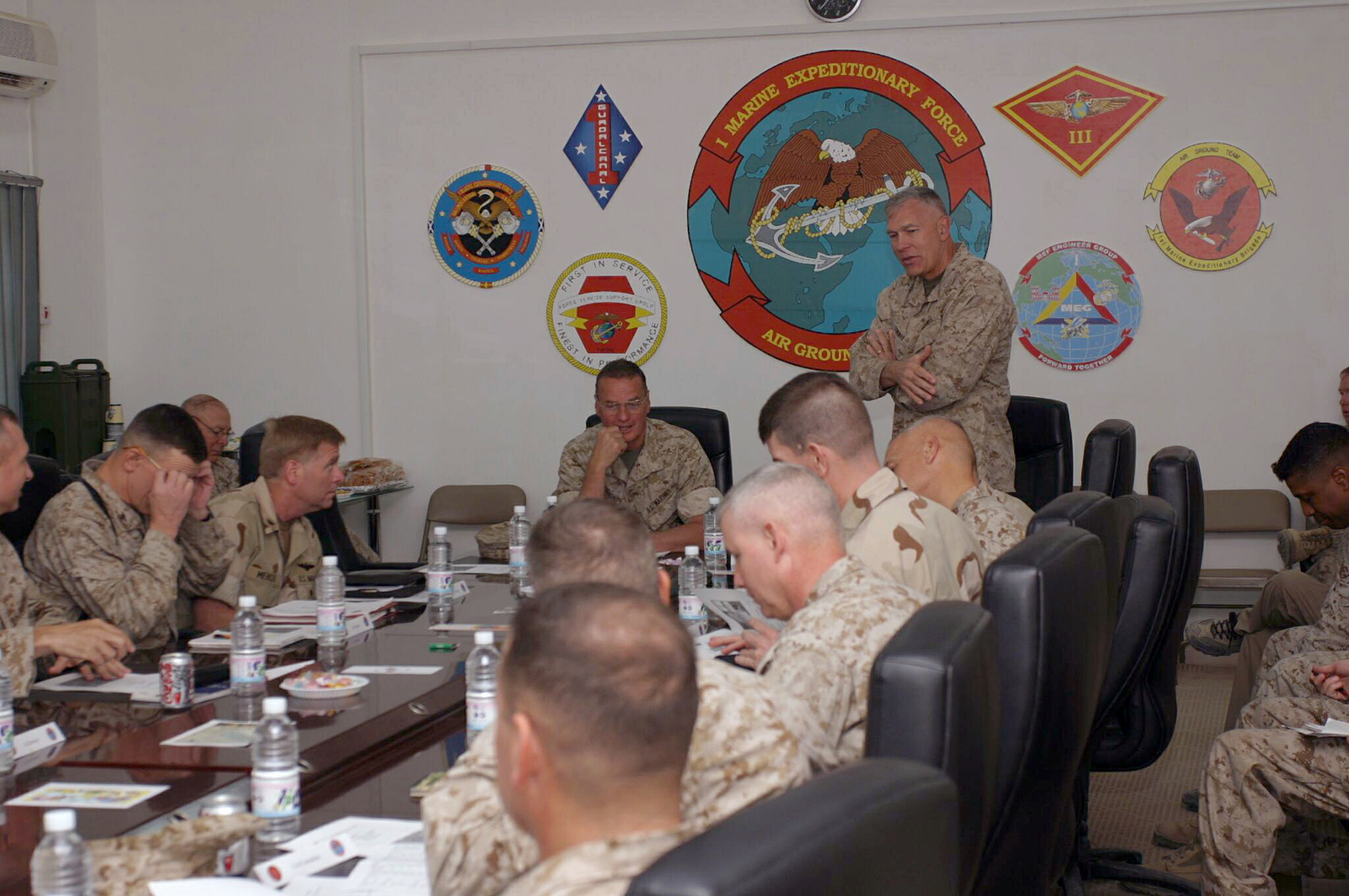 U.S. Marine Corps LT. GEN. James T. Conway (standing), Commander, I Marine Expeditionary Force (I-MEF), hosts a meeting with GEN. James L. Jones (rear, center), Supreme Allied Commander Europe (SACEUR), at Camp Fallujah, Al Anbar Province, Iraq, on Aug. 19, 2004, during Operation Iraqi Freedom.  (U.S. Marine Corps photo by SGT. Chad R. Kiehl) (Released)
