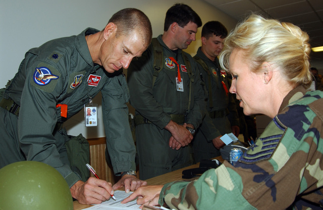 040820-F-3711S-050 (Aug. 20, 2004)US Air Force (USAF) LT. COL. Craig Schroeder, Operations Support, 119th Fighter Wing (FW), checks his name against the manifest while USAF SENIOR MASTER SGT. Leah Terry, Mission Support, looks on during an Operational Readiness Inspection (ORI), North Dakota Air National Guard (NDANG) Base, Fargo, North Dakota (ND).U.S. Air Force official photo by TECH SGT. Bradly Schneider  (RELEASED)