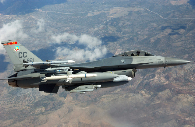 040820-F-6911G-001 (Aug. 20, 2004)US Air Force (USAF) F-16C Fighting Falcon, 27th Fighter Wing (FW), Cannon Air Force Base (AFB), New Mexico (NM), heads out on a mission somewhere over the Nevada Test and Training Range (NTTR), Nellis AFB, Nevada (NV), during RED FLAG 04-3.  The Falcon is armed with an AIM-7 Sparrow on the wing tip and an AIM-120A Advanced Medium Range Air-to-Air Missile (AMRAAM) and Air Combat Maneuvering Instrument (ACMI) Pod under the wing.U.S. Air Force official photo by TECH SGT. Kevin J. Gruenwald  (RELEASED)