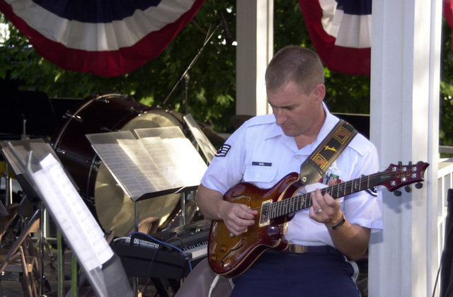 040824-F-4152L-006 (Aug. 24, 2004)US Air Force (USAF) STAFF SGT. Gary Noell from the USAF Band Of Liberty, Hanscom Air Force Base (AFB), Massachusetts (MA), warms up on his guitar before a concert at the North Hampton Community Bandstand in North Hampton, New Hampshire (NH).U.S. Air Force official photo by AIRMAN Curtis J. Lenz (RELEASED)