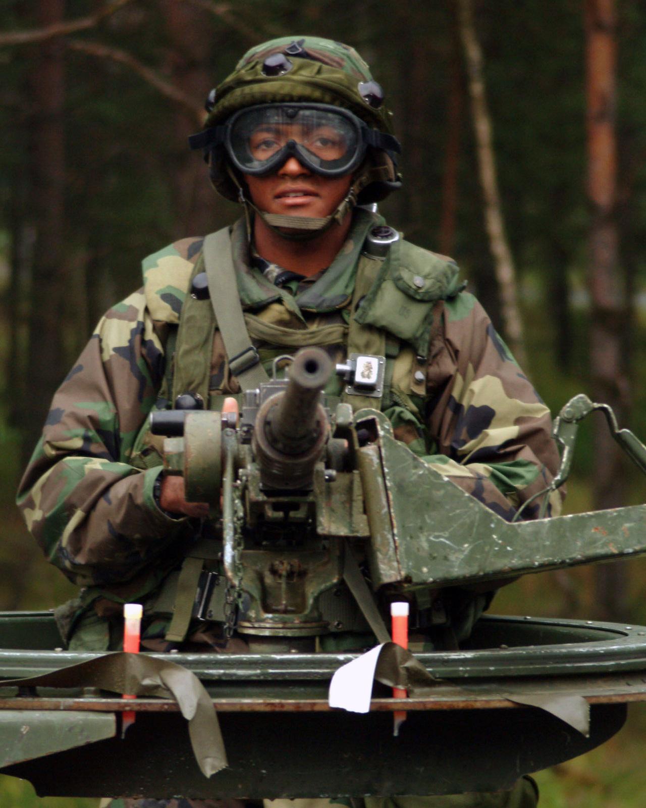 A U S Army Soldier 515th Transportation Battalion Waits Behind An M2 50 Caliber Machine Gun In