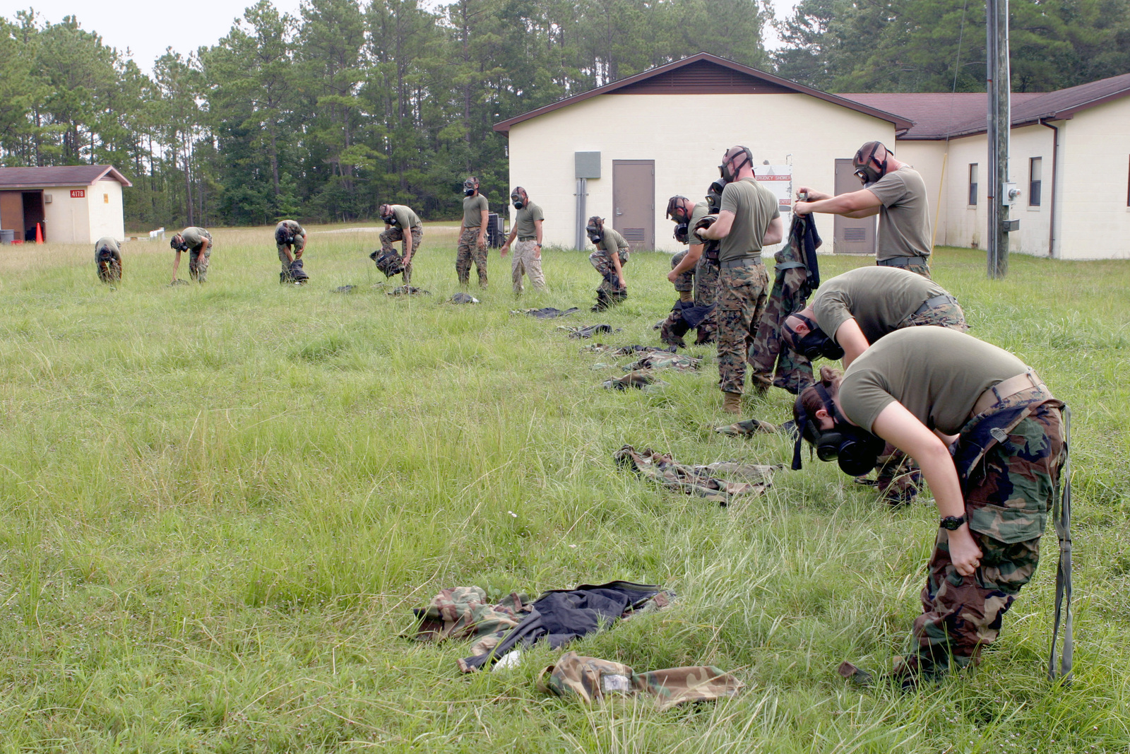 US Marine Corps (USMC) Marines strip off their Mission Oriented