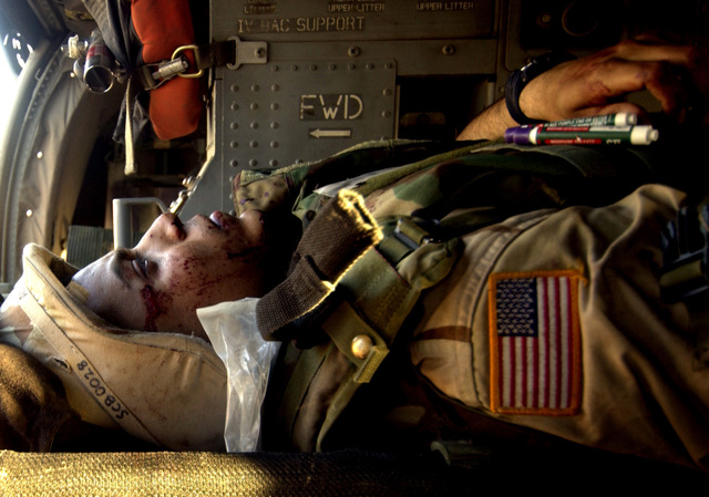 An injured US Army (USA) Soldier rests aboard an USA UH-60 Blackhawk (Black Hawk) Medical Evacuation (MEDEVAC) helicopter as he is airlifted to a Combat Support Hospital (CSH) for proper medical treatment. The Soldier sustained his injuries during a car accident in Baghdad, Iraq (IRQ), as was initially treated by USA Medical Technicians from the 45th Medical Brigade, before being airlifted from a landing zone at Camp Victory, Iraq (IRQ), during Operation IRAQI FREEDOM