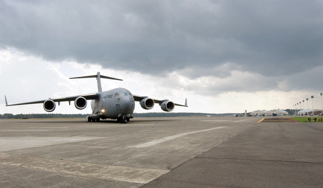 The first to arrive home, a U.S. Air Force C-17A Globemaster III aircraft, 62nd/446th Airlift Wing, number P-123, taxis into its parking spot on the empty McChord Air Force Base, Wash., flight line on Sept. 1, 2004. The airmen operated out of McGuire Air Force Base, N.J., and March Air Reserve Base, Calif., while McChord's runway was closed during August to complete the construction on its center section.  (U.S. Air Force photo by Kristin Royalty) (Released)