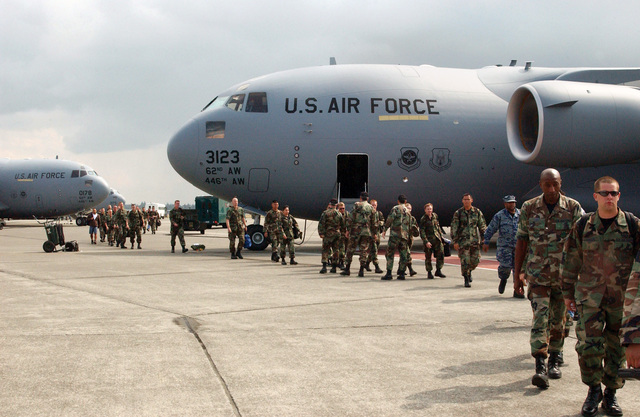 U.S. Air Force (USAF) personnel of the 62nd Airlift Wing, McChord Air Force Base, Wash., arrive home on Sept. 1, 2004, after temporary duty for nearly a month while their runway was under construction. The USAF C-17A Globemaster III cargo aircraft, aircrews and their maintenance workers, totaling approximately 150 Airmen, operated out of McGuire Air Force Base, N.J. and March Air Reserve Base, Calif., while construction of the center portion of the McChord runway was completed in the month of August. (U.S. Air Force photo by Kristin Royalty) (Released)