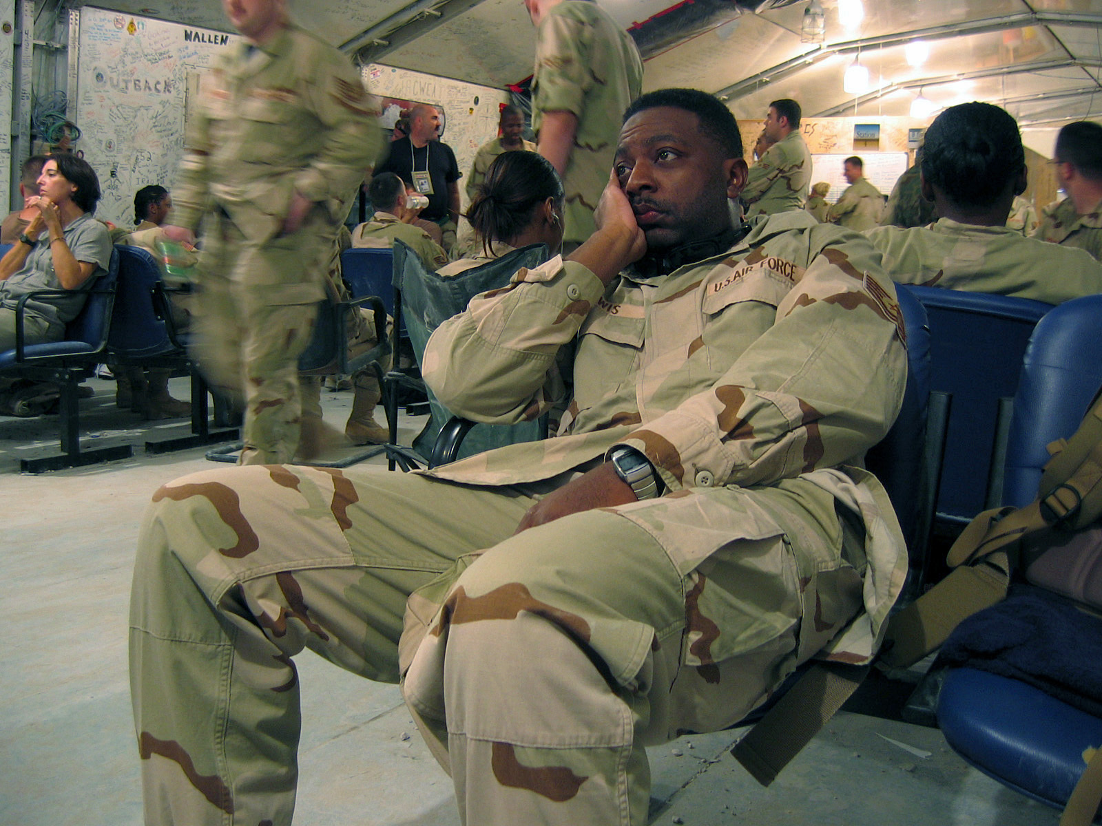 U.S. Air Force Technical Sergeant Marshall Lewis, Graphics Journeyman, Moody Air Force Base, Ga., part of a 5 airman Multimedia Team, patiently awaits a flight to Balad Air Base, Iraq, in the Passenger Terminal at Al Udeid Air Base, Qatar. (U.S. Air Force PHOTO by AIRMAN First Class Joshua T. Jasper)