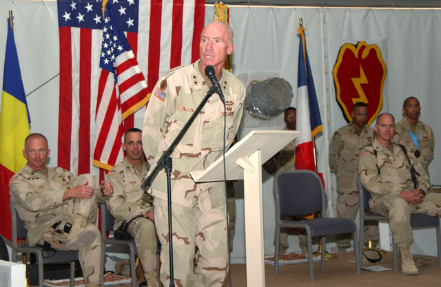 U.S. Army GEN. Eric T. Olson (left), Commander, Combined Joint Task Force 76 and 25th Infantry Division (Light), addresses Soldiers at Kandahar Airfield, Afghanistan, on Sept. 6, 2004, during a Combat Unit Patch ceremony. (U.S. Army photo by SPEC. Jerry T. Combs) (Released)