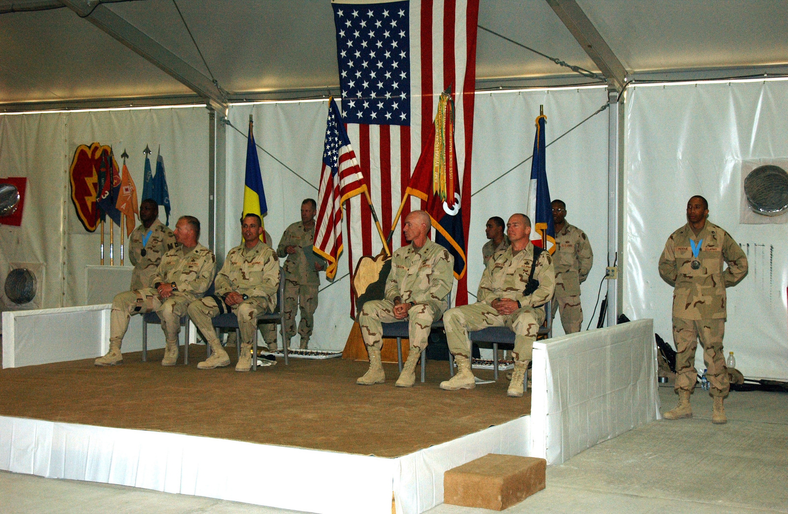 US Army (USA) Major General (MGEN) Eric Olson (seated second from right), Commander, Combined Task Force, listens with other members of the official party during an Award Ceremony for Soldier serving with the 25th Infantry Division Tropic Lightning, at Kandahar Airfield, Afghanistan, during Operation ENDURING FREEDOM. Soldiers of the 25th ID were presented with, Global War on Terrorism Medals, Combat Infantryman's Badge, Combat Medic's Badge and Combat Patches, during the Ceremony