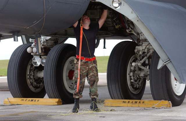 U.S. Air Force SENIOR AIRMAN Matt Gilbert, 36th Expeditionary Aircraft Maintenance Squadron, 36th Air Expeditionary Wing, Andersen Air Force Base, Guam, performs routine maintenance on a USAF B-52 Stratofortress after a training sortie on Sept. 7, 2004. (U.S. Air Force photo by AIRMAN First Class Kristin Ruleau) (Released)