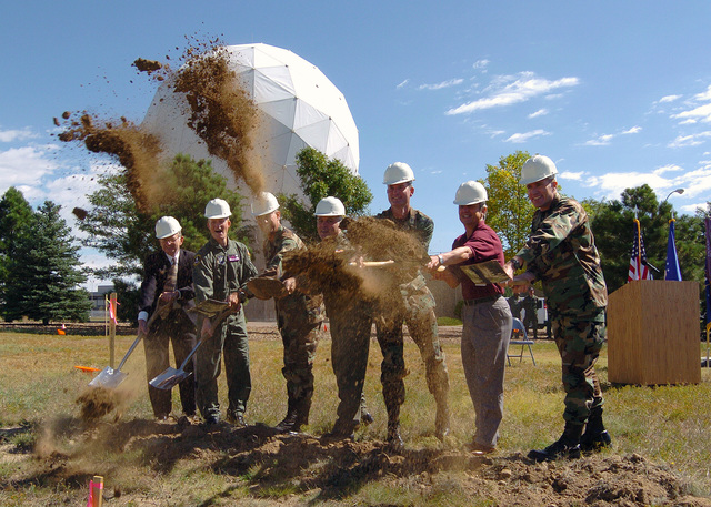 Members of the official party participate in the groundbreaking ceremony for the upgrade to the tracking system at Schriever Air Force Base, Colo., on Sept. 8, 2004. Pictured left-to-right: Honeywell Program Manager Mr. Roy Meadows; U.S. Air Force LT. COL. Michael Moran, Commander 22nd Space Operations Squadron; U.S. Air Force COL. Joseph Squatrito, Commander, 22nd Mission Support Group; U.S. Air Force COL. Michael Carey, Vice-Commander, 50th Space Wing; U.S. Air Force COL. avid Uhrich, Commander, Schriever Air Force Base; Mr. Brad Spink, Operational Space Services and Support Program Manager, Harris Corporation; and U.S. Air Force LT. COL. Steven Grupenhagen, CHIEF of Range evelopment...