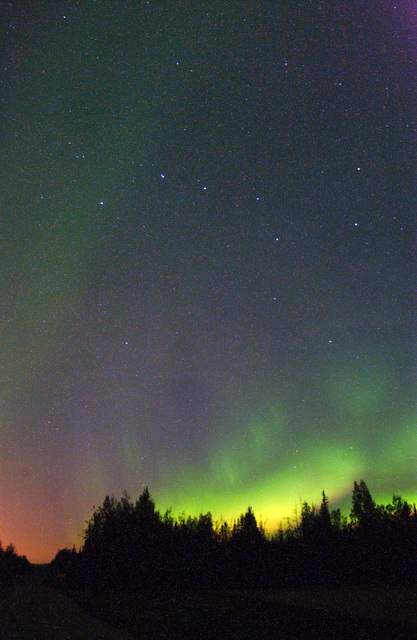 The Aurora Borealis, commonly knows as the Northern Lights, illuminates the early morning sky over Eielson Air Force Base, Alaska, on 8 September 2004. The lights are the result of solar particles colliding with gases in Earth's atmosphere. Early Eskimos and Indians believed different legends about the Northern Lights such as they were the souls of animals dancing in the sky or the souls of fallen enemies trying to rise again. (U.S. Air Force PHOTO by SENIOR AIRMAN Joshua Strang) (Released)