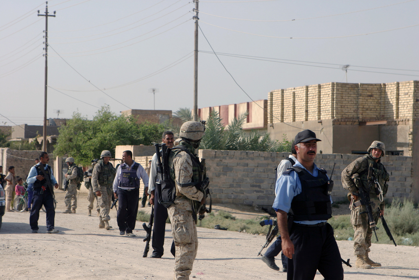 Iraqi security forces and US Marine Corps (USMC) Marine