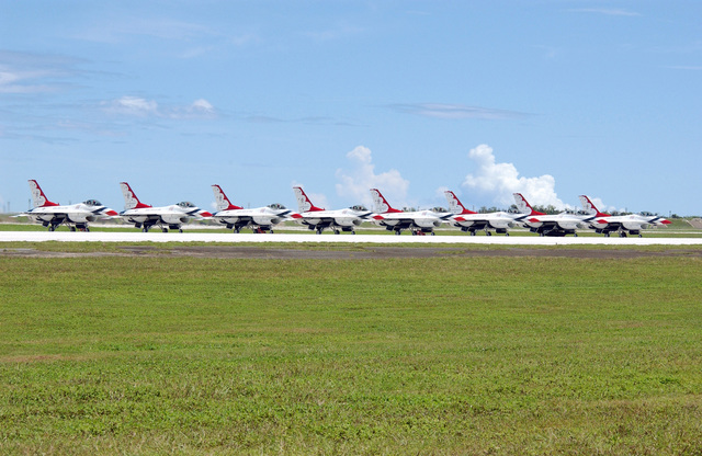 The U.S. Air Force Thunderbirds Aerial Demonstration Team F-16C Fighting Falcon aircraft are parked on the flight line at Andersen Air Force Base, Guam, September 9, 2004.  This landing marks the first time in a decade the Thunderbird Demonstration Team has visited Guam. The Thunderbirds will be performing during an air show held Sunday, September 12, 2004. (U.S. Air Force PHOTO by AIRMAN 1ST Class Kristin Ruleau) (Released)