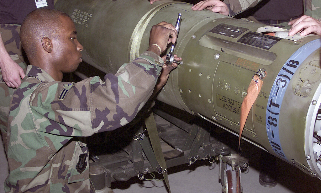 U.S. Air Force AIRMAN 1ST Class Emmanuel Smith a Ammunition Maintenance Technician, assembles a back side panel on a GBU-15, 2000-pound precision-guided munitions, while deployed with the 3rd Air Expeditionary Group at at Kwang-Ju Air Base, Republic of Korea, on September 9, 2004. (U.S. Air Force photo by STAFF SGT. Steven R. Nabor) (Released)
