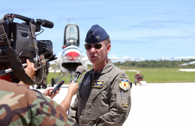U.S. Air Force COL. P. K. White, Commander, 36th Air Expeditionary Wing, is interviewed by members of the local media upon the arrival of the U.S. Air Force Thunderbirds Aerial Demonstration Team, at Andersen Air Force Base, Guam, September 9, 2004. This landing marks the first time in a decade the Thunderbirds Demonstration Team has visited Guam. The Thunderbirds will be performing during an air show held Sunday, September 12, 2004. (U.S. Air Force PHOTO by AIRMAN 1ST Class Kristin Ruleau) (Released)