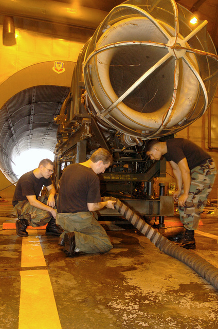 U.S. Air Force Jet Engine Mechanics assigned to the 20th Component Maintenance Squadron, prepare to test an F110 jet engine in the engine test cell at Shaw Air Force Base, S.C., on September 9, 2004. Pictured left-to-right: SENIOR AIRMAN Eric Hay; MASTER SGT. Kenneth Carr; and AIRMAN 1ST Class Jonathan Alicea. (U.S. Air Force PHOTO by MASTER SGT. Paul Holcomb) (Released)