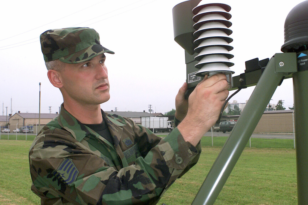 U.S. Air Force TECH. SGT. Scott Butler, a Weather Technician assigned to the 90th Fighter Squadron, Elmendorf Air Force Base, Alaska, adjusts the temperature sensor on a piece of TMQ-53 Tactical Meteorological Equipment, while deployed with the 3rd Air Expeditionary Group at Kwang-Ju Air Base, Republic of Korea on Sept. 9, 2004.  (U.S. Air Force PHOTO by TECH SGT. Corey A Clements) (Released)