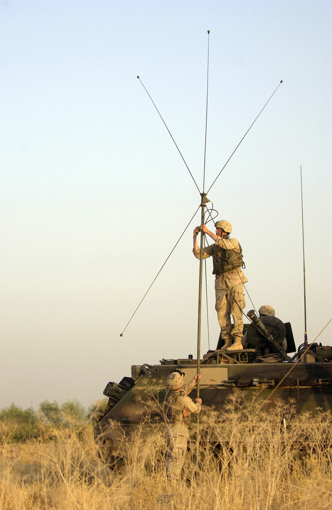 U.S. Army Soldiers assigned to Bravo Company, 1-185th Armor, 81st Armor Brigade, set up an antenna at their assembly area, during a three day area reconnaissance mission around Balad, Iraq, on September 9, 2004, during Operation Iraqi Freedom. The area reconnaissance mission is to deny anti-Iraqi forces the freedom to operate and move throughout the countryside. U.S. Air Force PHOTO by STAFF SGT. Shane A. Cuomo) (Released)