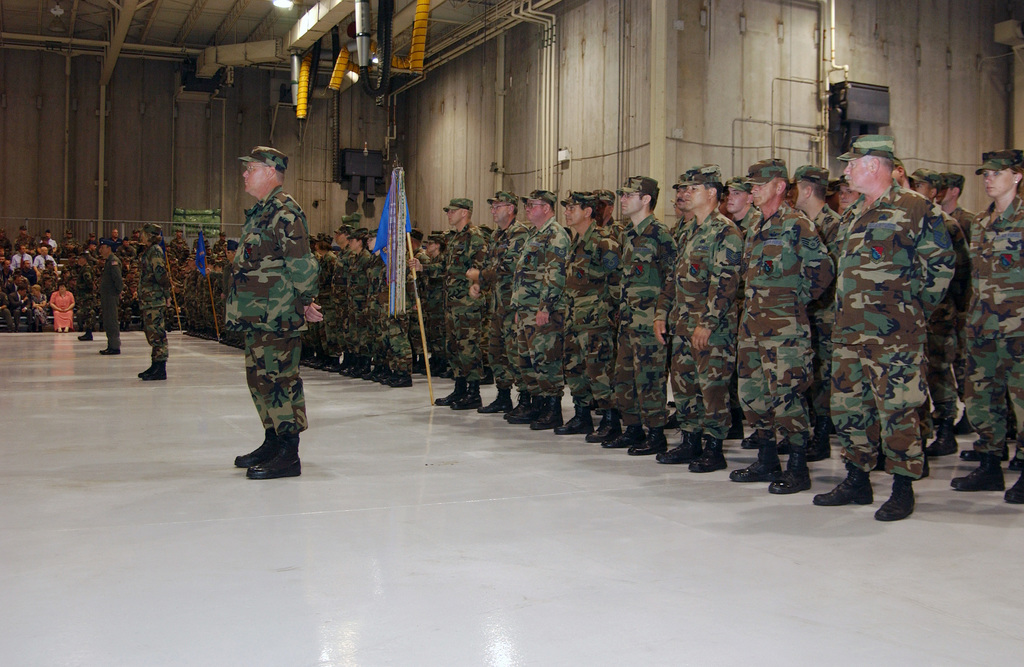 U.S. Air Force Airmen assigned to the 193rd Special Operations Wing, Pennsylvania Air National Guard, stand in formation during the Rollout Ceremony of the EC-130J Commando Solo aircraft, held inside the Fuel Cell Hangar at Harrisburg International Airport, in Middletown, Pa., September 10, 2004. (U.S. Air Force PHOTO by SENIOR AIRMAN Matt Schwartz) (Released)