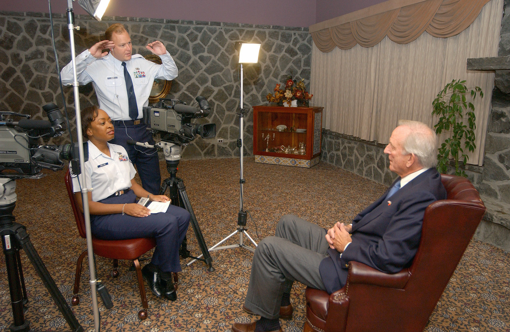 U.S. Ambassador to Portugal, John Palmer (right), prepares for a documented interview with U.S. Air Force TECH. SGT. Renee Kirkland, 65th Air Base Wing, Public Affairs, and STAFF SGT. Marty Rush, Det. 6, Air Force News, during his visit at Lajes Field, Azores on September 10, 2004. (U.S. Air Force PHOTO by STAFF SGT. Michelle Michaud) (Released)