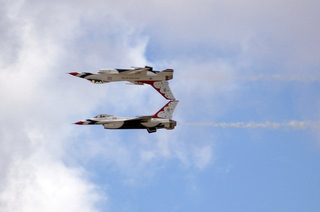 A U.S. Air Force Thunderbirds Aerial Demonstration Team F-16C Fighting Falcon aircraft performs an inverted flight maneuver during a performance for the Open House Air Show, Sept. 12, 2004, at Andersen Air Force Base, Guam. (U.S. Air Force PHOTO by AIRMAN 1ST Class Kristin Ruleau). (Released)