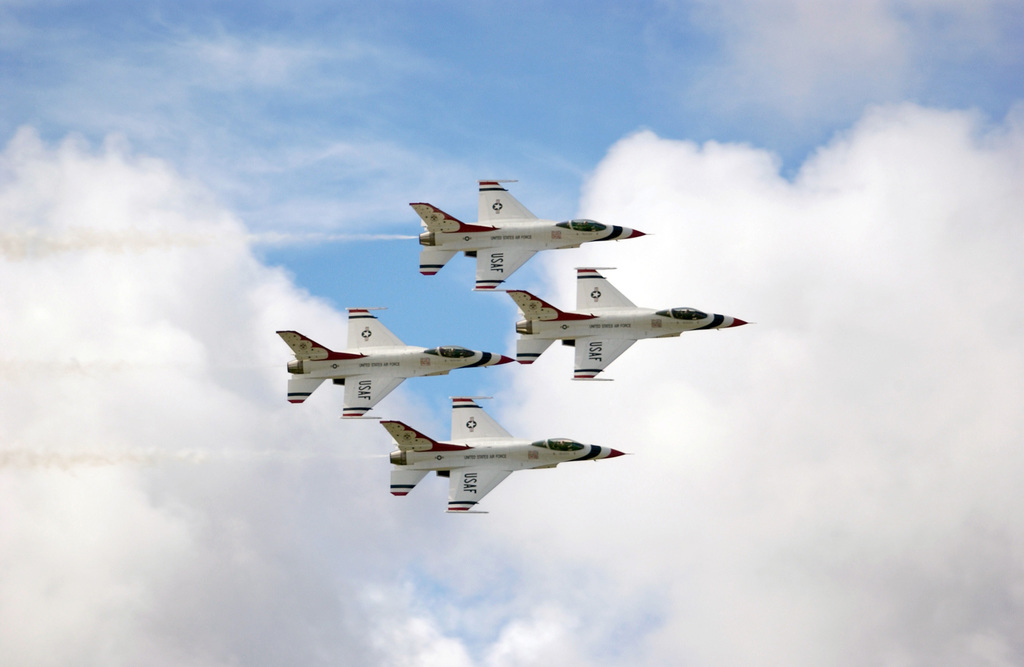 The U.S. Air Force Thunderbirds Aerial Demonstration Team F-16C Fighting Falcon aircraft perform during the Open House Air Show, Sept. 12, 2004, at Andersen Air Force Base, Guam. (U.S. Air Force PHOTO by AIRMAN 1ST Class Kristin Ruleau). (Released)