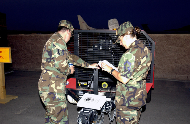 U.S. Air Force SENIOR MASTER SGT. Kathleen Werle-Bushnell, right, 99th Civil Engineering Squadron, and TECH. SGT. Jon Leone, left) spot check an Eagle Air Compressor as part of a phase one Operational Readiness Exercise at Nellis Air Force Base, Nev., on Sept. 13, 2004.(U.S. Air Force PHOTO by STAFF SGT. Darryl Barnes) (RELEASED)