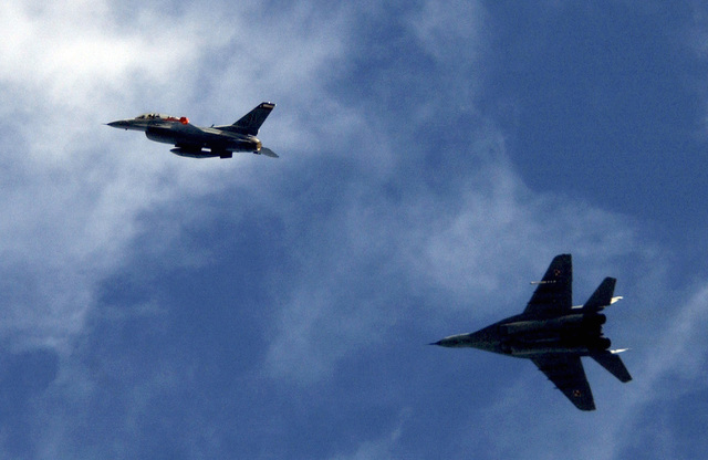 A Texas Air National Guard F-16D Fighting Falcon fighter aircraft, (right), 182nd Fighter Squadron, Lackland Air Force Base, San Antonio Texas, flies alongside a Polish MIG-29 Fulcrum fighter aircraft (left), at Lask Polish Air Base, Poland on Sept. 14, 2004.(U.S. Air Force PHOTO by TECH. SGT. Justin D. Pyle) (RELEASED)