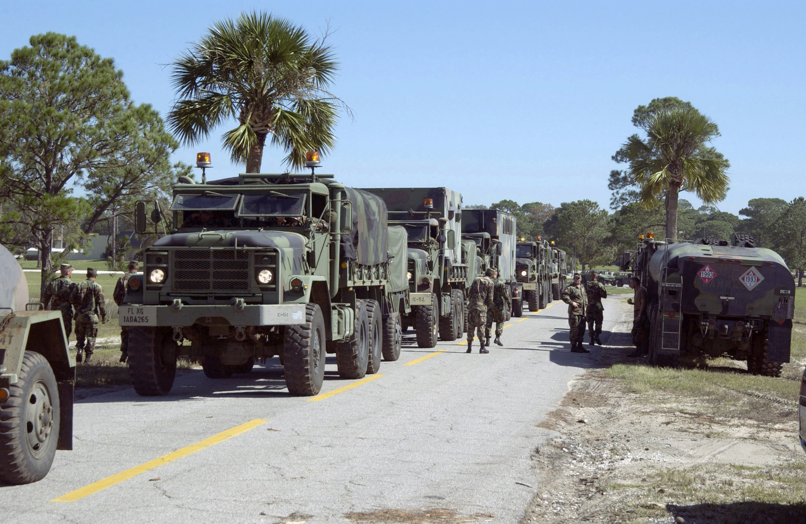 A supply truck convoy from the Florida Army National Guard personnel prepare to provide humanitarian relief to victims of Hurricane Ivan at MacDill Air Force Base, Fla., on Sept. 17, 2004.(U.S. Air Force PHOTO by Steven Wallace, CIV.) (RELEASED)