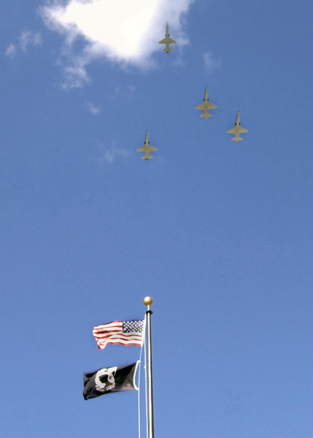 U.S. Air Force T-38 Talon jet trainers, perform the traditional missing man flyover over the United States of America and POW flags on a flagpole during retreat on National POW/MIA Recognition Day at Heritage Park, Laughlin Air Force Base, TX, on Sept. 17, 2004.U.S. Air Force PHOTO by Jose Mendoza, CIV.) (RELEASED)