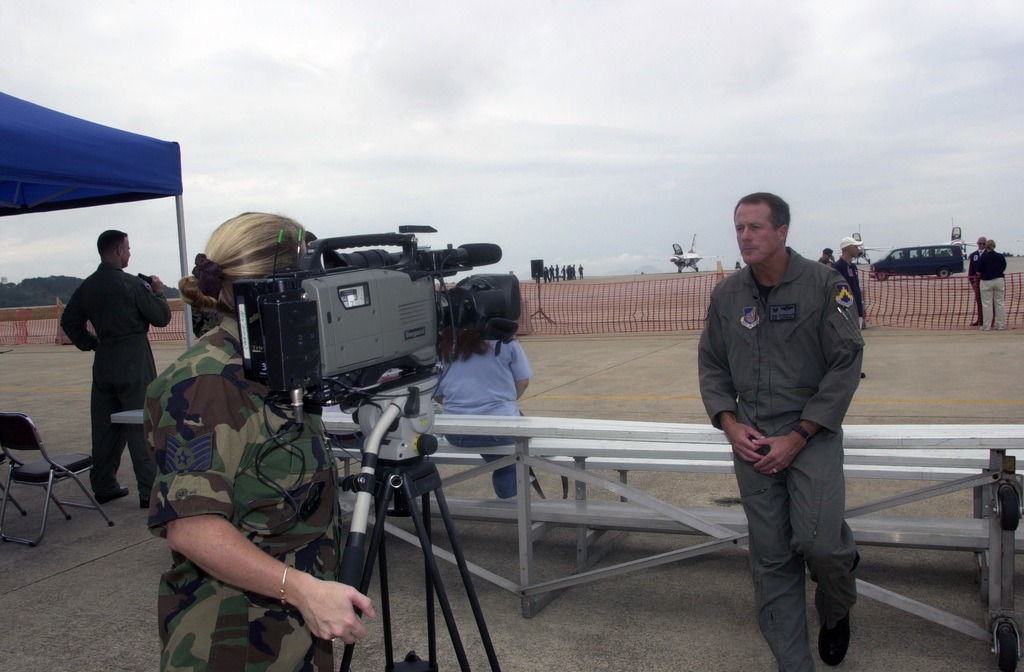 U.S. Air Force TECH. SGT. Mills, Armed Forces Network Korea, interviews COL. Strickland, Commander, 8th Operations Group, on camera during the Kunsan Air Show at Kunsan Air Base, Republic of Korea, on Sept. 17, 2004.(U.S Air Force PHOTO by STAFF SGT. Alan W. Port) (RELEASED)