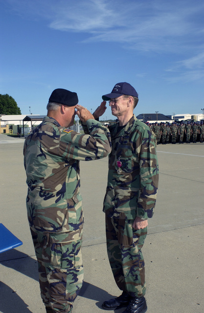Indiana Air National Guard 181st Fighter Wing COL. Kent Waggoner (retired), former Vice Commander,  salutes the Indiana Adjutant General, Indiana National Guard, MAJ. GEN. R. Martin Umbarger, after being pinned with the Legion of Merit medal at Selfridge Air National Guard Base, Michigan on Sept. 18, 2004..(U.S. Air Force PHOTO by TECH. SGT. John M. Day) (RELEASED)