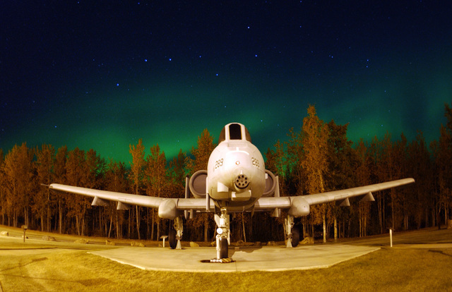 The Big Dipper constellation and the Aurora Borealis, or Northern Lights, shine above a static A-10 Thunderbolt II in Heritage Park at Eielson Air Force Base, Alaska, on Sept. 18, 2004. The Borealis are the result of solar particles colliding with gases in Earth's atmosphere. Early Eskimos and Indians believed different legends about the Northern Lights such as they were the souls of animals dancing in the sky or the souls of fallen enemies trying to rise again. The 355th Fighter Squadron stationed at Eielson currently flies the Thunderbolt aircraft. (U.S. Air Force photo by SENIOR AIRMAN Joshua Strang) (Released) (SUBSTANDARD)