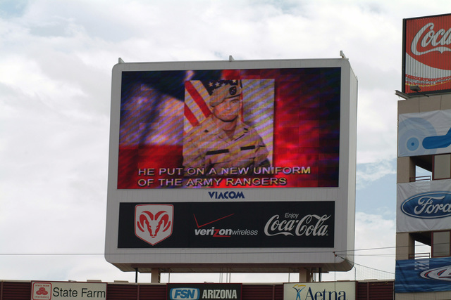 Displayed on the Jumbotron, images of Pat Tillman during U.S. President George H.W. Bush's speech during the dedication ceremony, at the Cardinals Football Stadium in Phoenix, Ariz., honoring his dedication and patriotism for his country. Pat Tillman left the NFL Cardinals, became a U.S. Army Ranger and was part of the 75th Ranger Regiment to fight terrorism in Afghanistan. He was killed in action on April 22, 2004. (U.S. Air Force photo by MASTER Sergeant Michael C. Burns) (Released)