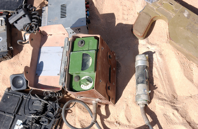 A Union of Soviet Socialist Republics (USSR) transceiver (green), circa 1950's, other communications equipment, found by Iraqi Security Forces during a raid of a Muqtada al Sadr safe house in An Najaf, An Najaf Province, Iraq, are displayed by U.S. Marine Corps Marines, 11th Marine Expeditionary Unit (MEU) Special Operations Capable, Sept. 21, 2004. These caches were found in different buildings among the city are in direct violation of the peace agreement between the Gr Ayatollah Sayyid Ali Husaini al-Sistani, highest religious authority leader of the Hawza (Najaf), al Sadr, an agreement blessed by the Iraqi Interim Government. The 4th MARDIV is engaged in Security...