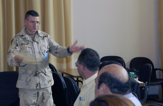 U.S. Army MAJ. Henry J. Schiller, 61-J General Surgery Trauma Director, 44th Medical Brigade, briefs an audience of Iraqi Doctors as part of a two-day conference on Sept. 1, 2004, during Operation Iraqi Freedom. The Combat Support Hospital in Baghdad is holding a trauma symposium designed to familiarize Iraqi doctors on up-to-date techniques for the treatment of trauma patience. (U.S. Air Force photo by MASTER SGT. Michael E. Best) (Released)
