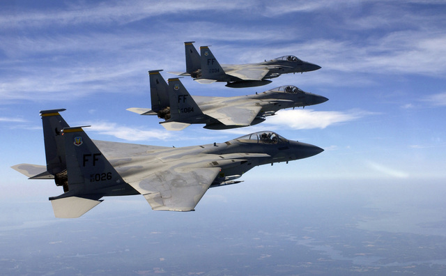 U.S. Air Force F-15C Eagle fighters, piloted by USAF MAJ. Peter Milohnic (foreground), USAF CAPT. Jonathan Gration and USAF LT. COL. John Saghere (rear), 27th Fighter Squadron (FS), Langley Air Force Base, Va., make their way out to the training area over the Atlantic Ocean during the Eagle's last week of flying under this squadron on Sept. 22, 2004.  After October 1ST, the 27th FS will officially migrate from an F-15 squadron to the first operational F/A-22 Raptor squadron currently due to arrive in mid 2005. (U.S. Air Force photo by Technical Sergeant Ben Bloker) (Released)