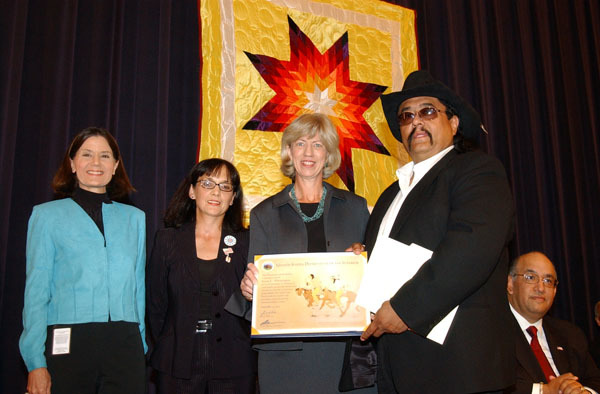 Secretary Gale Norton with Jesse Monongya, jeweler and Indian Arts and Crafts Board Commissioner, right, honoree at Living Legacy Awards event, recognizing contributions to Native American arts promotion, at Department of Interior headquarters, Washington, D.C.
