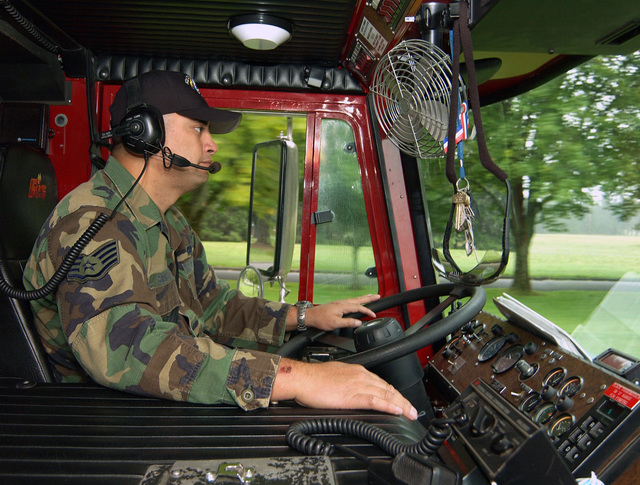 U.S. Air Force STAFF SGT. Tanner Scanlan, 62nd Civil Engineer Squadron, drives Engine 911 fired truck at McChord Air Force Base, Wash., on Sept. 27, 2004. (U.S. Air Force PHOTO by Kevin Tosh, CIV.) (RELEASED)