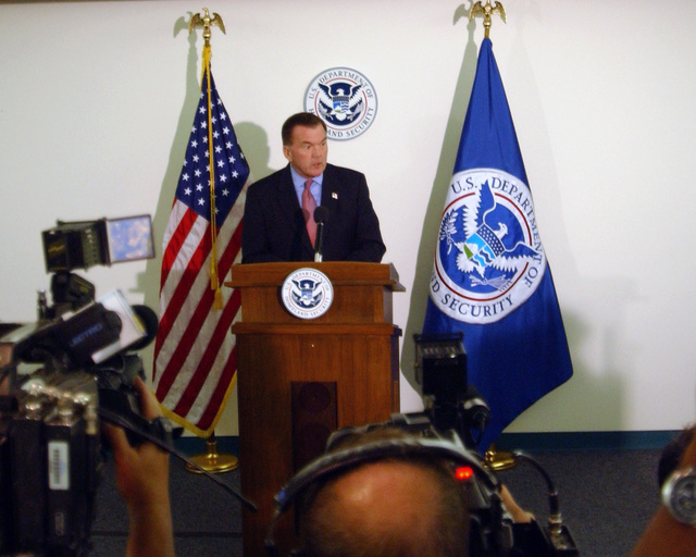 The Honorable Tom Ridge Secretary of The Department of Homeland Security, addresses the news media from the podium at the Air and Marine Operations Center, run by the U.S. Customs Agency, during his tour of the facility at March Air Reserve Base, Calif., on Sept. 28, 2004.  (U.S. Air Force PHOTO by MASTER SGT. Bill Kimble) (RELEASED)