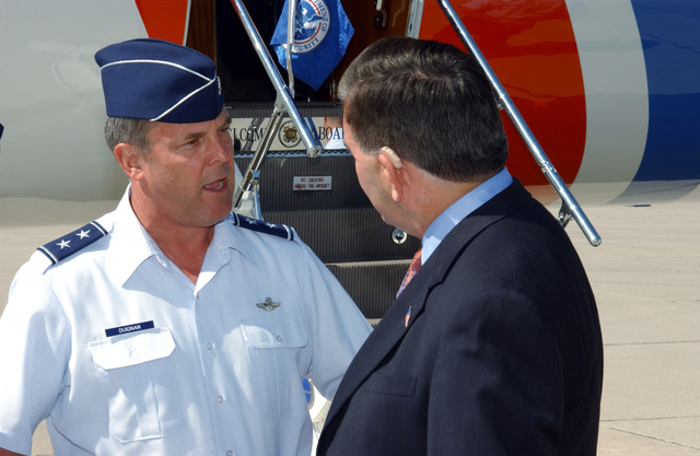 The Honorable Tom Ridge Secretary of The Department of Homeland Security, talks with MAJ. GEN. Robert E. Duigan, Commander of 4th Air Force, prior to a tour of the Marine Operations Center Air run by the U.S. Customs Agency, at March Air Reserve Base, Calif., on Sept. 28, 2004.  (U.S. Air Force PHOTO by MASTER SGT. Bill Kimble) (RELEASED)
