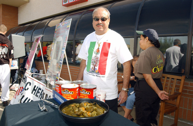 Mr. Mario Cassillas, a GS-5 civilian, has hot Jalapeno peppers ready for the contestants to eat during the Hispanic Heritage Taste of Culture event being held in front of the Base Exchange at Sheppard Air Force Base, TX, on Oct. 2, 2004, which is part of the National Hispanic Observation Month. (U.S. Air Force photo by Mike Fiore, Civilian) (Released)