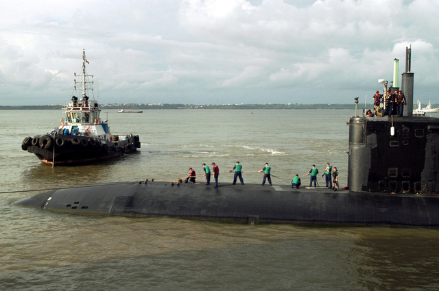 The US Navy (USN) Los Angeles Class Attack Submarine USS ALEXANDRIA (SSN 757), gets assistance from a commercial tugboat, while conducting mooring operations after arriving in port at Goa, India, during Exercise MALABAR 04. The Exercise includes maritime interdiction, air events, surface and sub-surface events, and personnel exchanges, and is designed to increase interoperability between the two navies while enhancing the cooperative security relationship between India and the United States