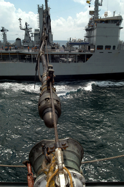 A refueling probe from the Indian Navy Modified Deepak Class Replenishment and Repair Ship INS (Indian Navy Ship) ADITYA (A 59), is guided into a fueling receiver port, aboard the Oliver Hazard Perry Class Guided Missile Frigate USS GARY (FFG 51) during Exercise MALABAR 04. Exercise MALABAR 04 is designed to increase interoperability between the two navies while enhancing the cooperative security relationship between India and the United States. The at-sea exercise includes maritime interdiction, surface events, sub-surface, air events, and personnel exchanges