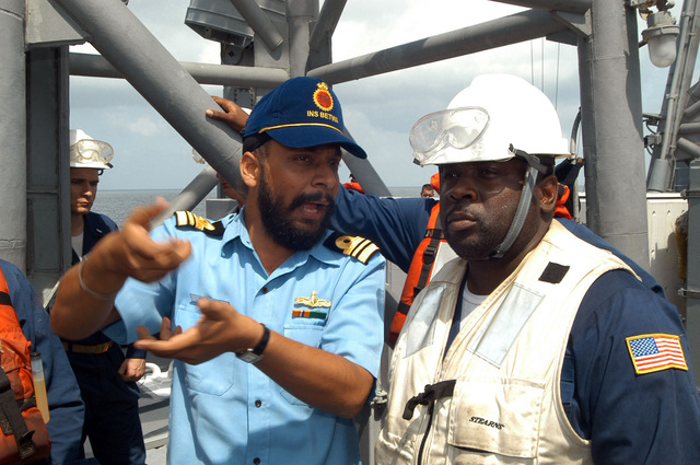 Indian Naval Lieutenant Commander (LCDR) Amarjeet Saluja (left), an anti-submarine warfare specialist on board the Indian Godavari Class Frigate INS (Indian Navy Ship) BETWA (F 32), discusses underway replenishment (UNREP) procedures with US Navy (USN) CHIEF Boatswain's Mate (BMC) Ricky Cambridge, Oliver Hazard Perry Class Guided Missile Frigate USS GARY (FFG 51). The GARY and other USN ships are taking part in Exercise MALABAR '04 with the Indian Navy to increase interoperability between the two navies while enhancing the cooperative security relationship between India and the United States